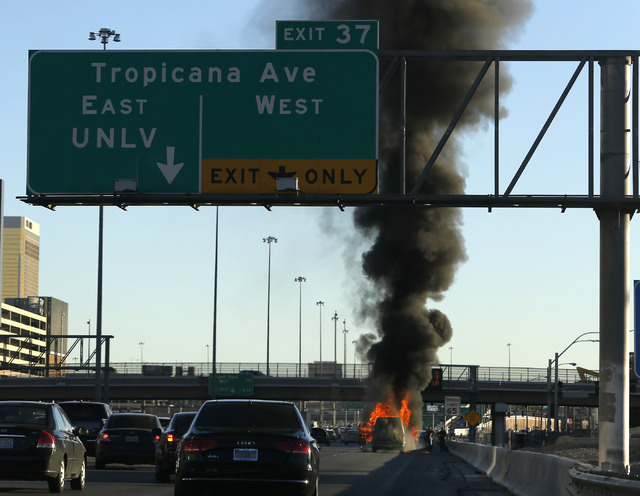 A vehicle engulfed in flames on I-15 south near exit 37 on Saturday, Jan. 28, 2017, in Las Vegas.