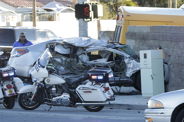 Las Vegas police investigate a crash involving a school bus, with no students on board, and a car at Ann Road and Durango Drive, Tuesday, Jan. 24, 2017, in Las Vegas. (Bizuayehu Tesfaye/Las Vegas  ...