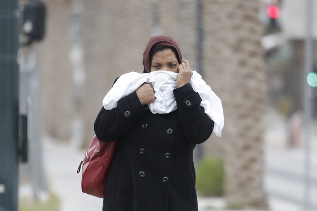 A pedestrian is bundled up against the cold weather on Bonneville Avenue in downtown Las Vegas, Monday, Jan. 2, 2017. (Bizuayehu Tesfaye/Las Vegas Review-Journal)@bizutesfaye