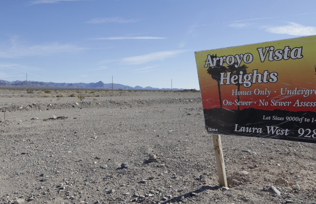 A sign on a vacant lot at the failed Arroyo Vista Heights subdivision project on Corwin Road in Bullhead City, Ariz., on Thursday, Jan 6, 2017. (Bizuayehu Tesfaye/Las Vegas Review-Journal)@bizutesfaye