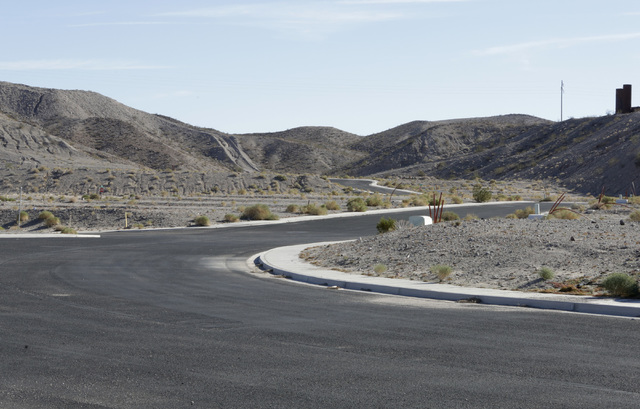 The paved road that leads to the failed subdivision project on Ranch Colorado Boulevard in Bullhead City, Ariz., on Thursday, Jan 6, 2017. (Bizuayehu Tesfaye/Las Vegas Review-Journal)@bizutesfaye
