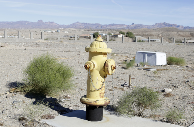 A fire hydrant among dry bushes at the failed subdivision project on Ranch Colorado Boulevard in Bullhead City, Ariz., on Thursday, Jan 6, 2017. (Bizuayehu Tesfaye/Las Vegas Review-Journal)@bizute ...