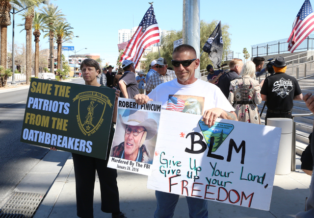 People, including Lyndy Jones, left, and Randy Peck, protest outside federal court in Las Vegas on March 10, 2016, before Cliven Bundy's court appearance. Bizuayehu Tesfaye/Las Vegas Review-Journa ...