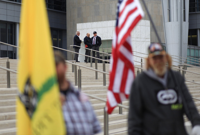Security keeps an eye on demonstrators in support of Bundy outside the Lloyd George U.S. Courthouse in Las Vegas on Dec. 9, 2016. (Brett Le Blanc/Las Vegas Review-Journal) Follow @bleblancphoto