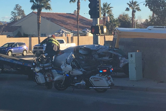 Las Vegas police investigate a crash involving a school bus, with no students on board, and a car at Ann Road and Durango Drive, Tuesday, Jan. 24, 2017. (Bizuayehu Tesfaye/Las Vegas Review-Journal ...