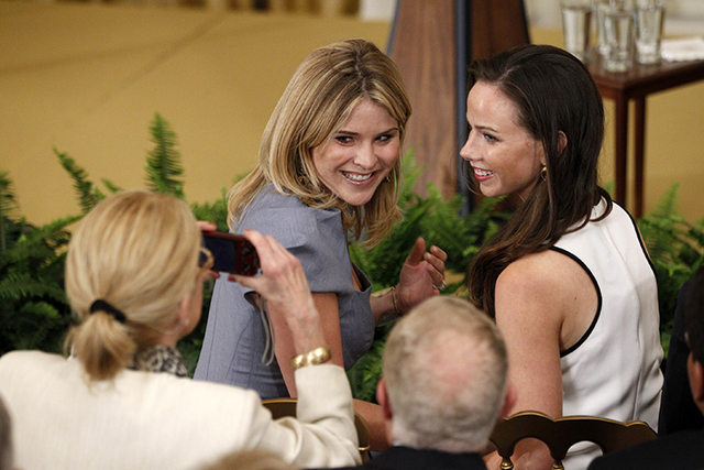 Former President George W. Bush's daughters, Jenna and Barbara, have their photo taken in the East Room at the White House in Washington prior to the unveiling of President Bush's official portrai ...