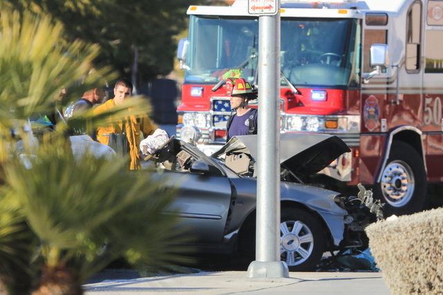 North Las Vegas police and Las Vegas firefighters work the scene of a crash Jan. 6 on Martin Luther King Boulevard near Carey Avenue. The city's VIPS Citizen's Patrol Program members control tra ...