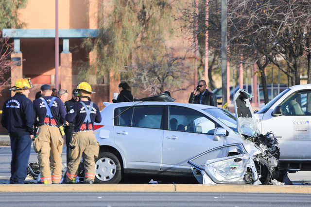 North Las Vegas police and Las Vegas fire fighters work the scene of a crash on Martin Luther King Boulevard near Carey Avenue on Friday, Jan. 6, 2017. Brett Le Blanc/Las Vegas Review-Journal Foll ...