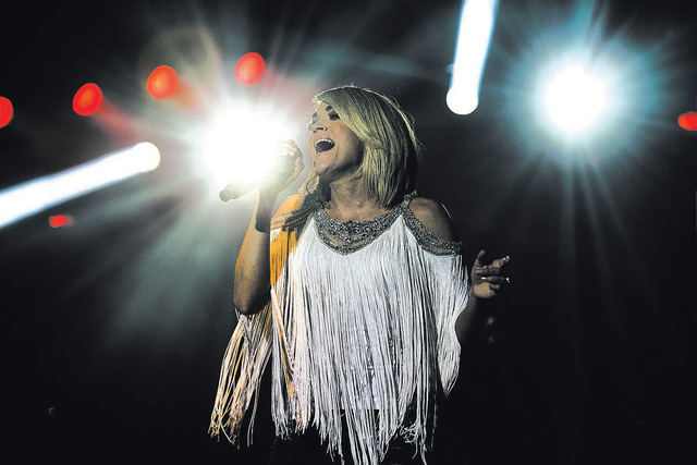 """Carrie Underwood performs during the first day of the American Country Music's """"Party for a Cause,"""" event at the Las Vegas Festival Grounds on Friday, April 1, 2016 in Las Vegas. ..."""