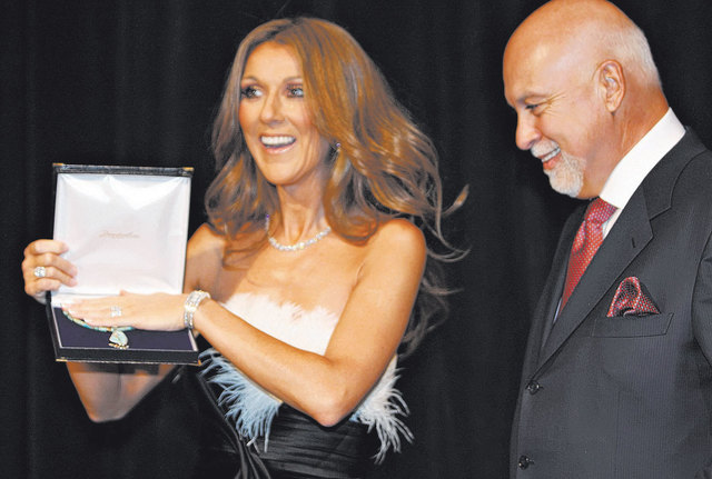 Entertainer Celine Dion holds a Nevada-mined turquoise necklace presented to her by then Nevada first lady Dawn Gibbons while Dion's husband, Rene Angelil, is beside her on Dec. 13, 2007, at Caesa ...