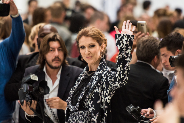 Celine Dion waves at photographers before Giambattista Valli's fall-winter 2016-2017 haute-couture fashion collection presented in Paris, France, in 2016. (Zacharie Scheurer/Associated Press)