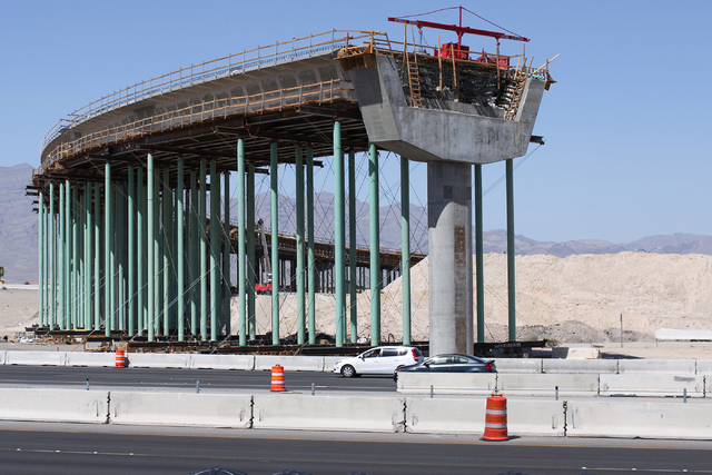Cars on U.S. Highway 95 pass by an overpass being built in the Centennial bowl in Las Vegas on Monday, July 11, 2016. (Brett Le Blanc/Las Vegas Review-Journal) @bleblancphoto