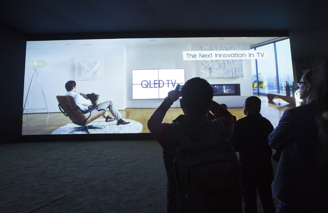 People view a 22' x55' screen in the Samsung booth during CES 2017 in the Las Vegas Convention Center on Friday, Jan. 6, 2017. Around 175,000 people are expected the attend the world's largest con ...