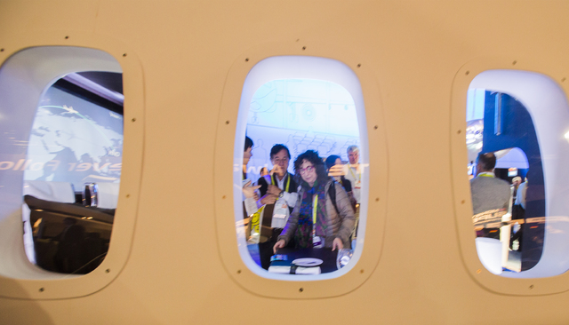 People view a replica of an airline fuselage in the Panasonic booth during CES 2017 in the Las Vegas Convention Center on Friday, Jan. 06, 2017. Around 175,000 people are expected the attend the w ...
