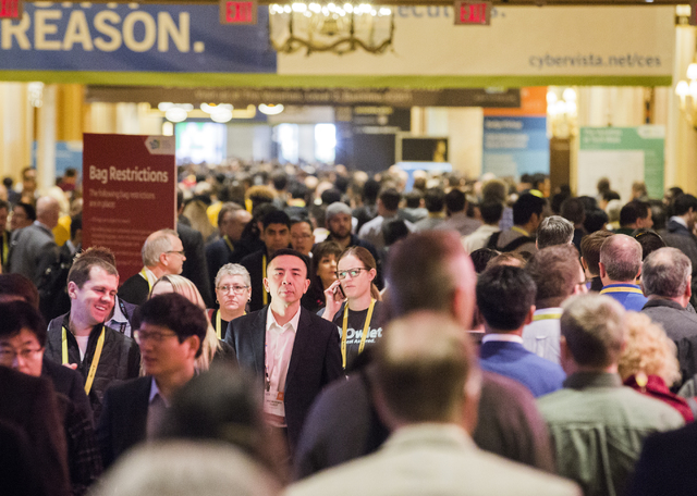 People walk in the hallway at The Venetian during CES 2017 on Thursday, Jan. 5, 2017. Around 175,000 people are expected the attend the world's largest consumer electronic trade show. Jeff Scheid/ ...