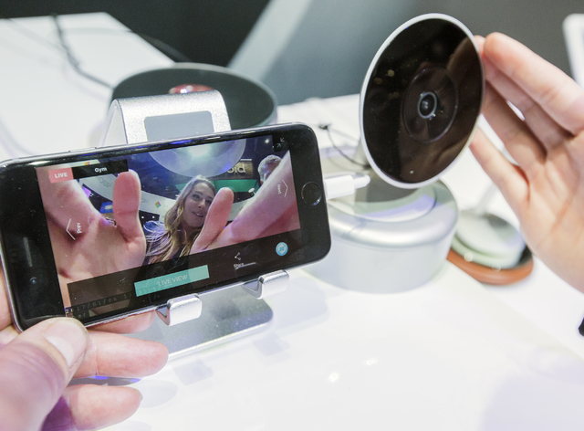 Madison Immediato with Polaroid, demonstrates the Hoop intelligent home camera during CES 2017 in the Las Vegas Convention Center on Friday, Jan. 06, 2017. Around 175,000 people are expected the a ...