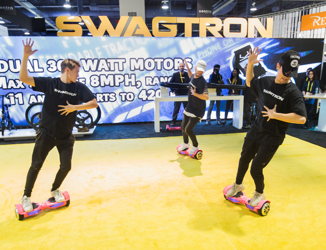 A dance group performs on Swagtron hoverboards during CES 2017 at the Las Vegas Convention Center on Thursday, Jan. 05, 2017. Around 175,000 people are expected the attend the world's largest cons ...