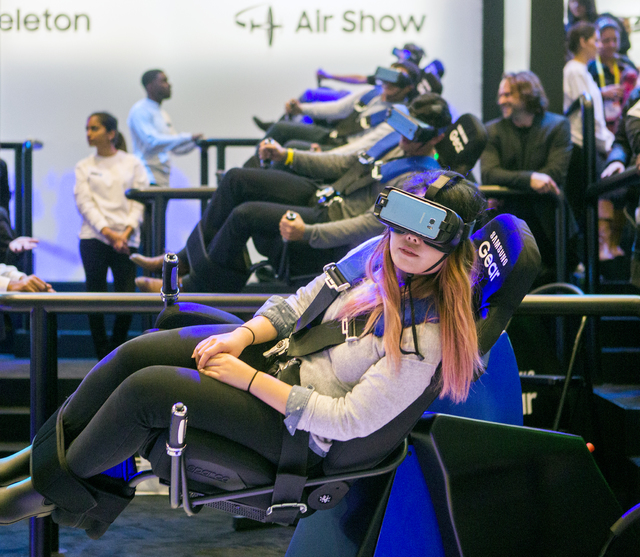 People experience the Samsung Galaxy Air Show virtual reality thrill ride during CES 2017 at the Las Vegas Convention Center on Thursday, Jan. 05, 2017. Around 175,000 people are expected the atte ...