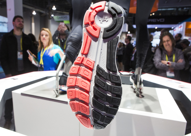 People look at the new wearable Under Armour Speed Form running shoe during CES 2017 at the Sands Convention Center on Thursday, Jan. 05, 2017. Around 175,000 people are expected the attend the wo ...