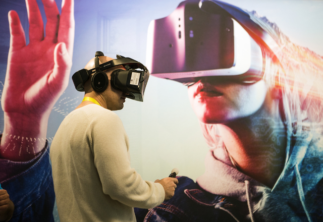 A man experiences the Intel's latest released Project Alloy standalone virtual reality headset Thursday, Jan. 05, 2017, during CES 2017 at the Las Vegas Convention Center. Around 175,000 people ar ...
