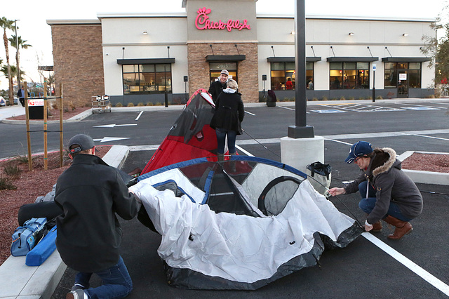 Taylor Ball, left, his wife, Janae, right, and Kirk Philips and his wife, Samantha, center, set up their tents outside Chick-fil-A at 9925 S. Eastern Ave. in Henderson Wednesday, Jan. 25, 2017. (B ...