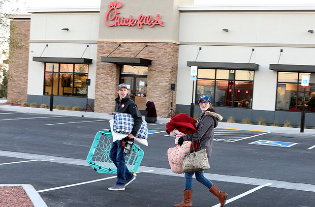 Taylor Ball, left, and his wife, Janae, arrive at Chick-fil-A at 9925 S. Eastern Ave. in Henderson to camp outside the restaurant for the chance to win free meal for a year on Wednesday, Jan. 25,  ...