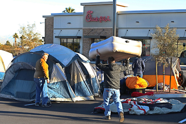 Paul Missimer, left, and Nick Luers, both of Henderson, set up their tent outside Chick-fil-A in Henderson Wednesday, Jan. 25, 2017. Hardcore fans camp outside the restaurant for the chance to win ...