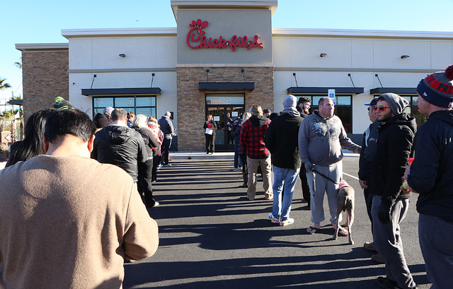 Chris Hoga, center, Chick-fil-A marketing director, calls numbers during the first line check outside Chick-fil-A at 9925 S. Eastern Ave. in Henderson Wednesday, Jan. 25, 2017.  (Bizuayehu Tesfaye ...