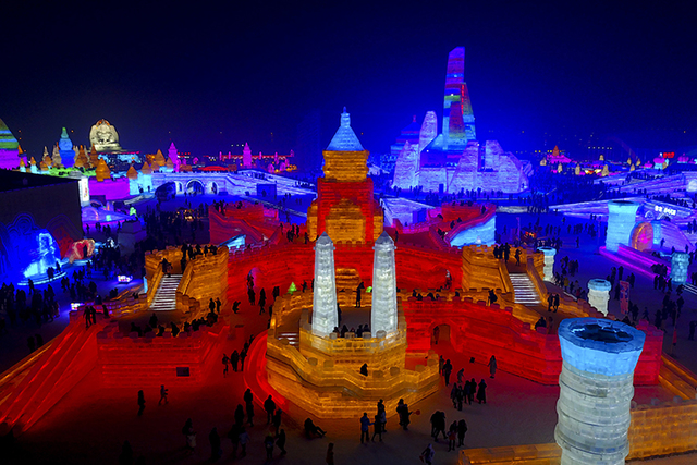Visitors tour a castlelike structure made from blocks of ice at the Harbin International Ice and Snow festival held in Harbin in northeastern's China's Heilongjiang province. The city of Harbin in ...