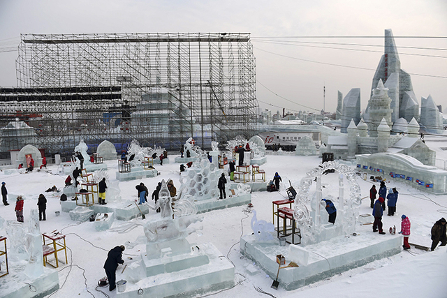 Contestants carve ice sculptures during an international ice sculpture contest as part of the Harbin Ice and Snow festival in Harbin, capital of northeast China's Heilongjiang Province. The city o ...