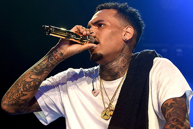 Chris Brown is shown performing at Drai's Beachclub's grand opening of Nightsplash in July. (Courtesy)