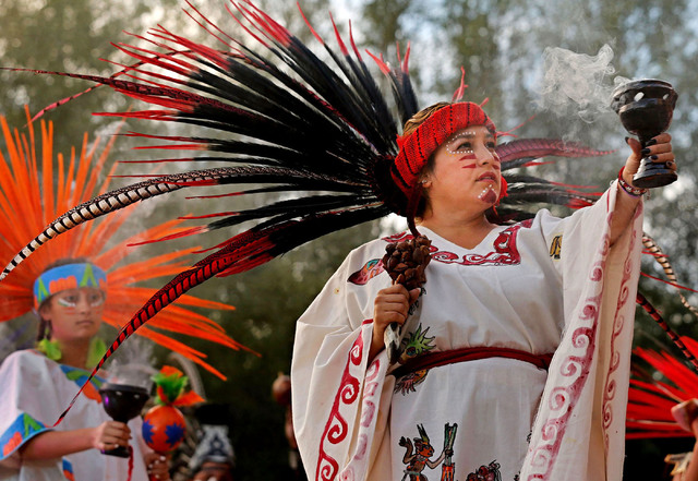 Dance troupe Xochipilli members including  Carla Mendez, right, and her daughter Carolina Mendez, 15, left, perform an Aztec dance during the ninth annual Da de Muertos event at  the Springs Prese ...