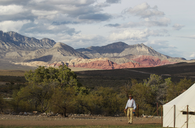 Red Rock Canyon is highlighted in the background during the Spring Mountain Free Trappers Mountain Man Rendezvous at Spring Mountain Ranch State Park on Oct. 29, 2016. (Chase Stevens/Las Vegas Rev ...