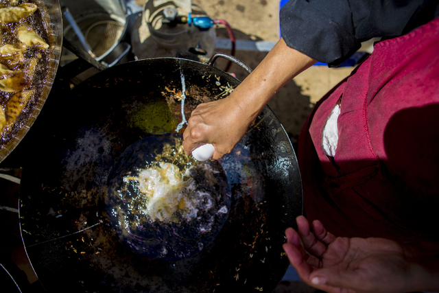 Pannee Thompson owner of Taste of Asia cracks an egg to make Pad Thai during the first day of the Annual Pacific Islands Festival Saturday, Sept. 10, 2016, in Henderson, NV. (Elizabeth Page Brumle ...