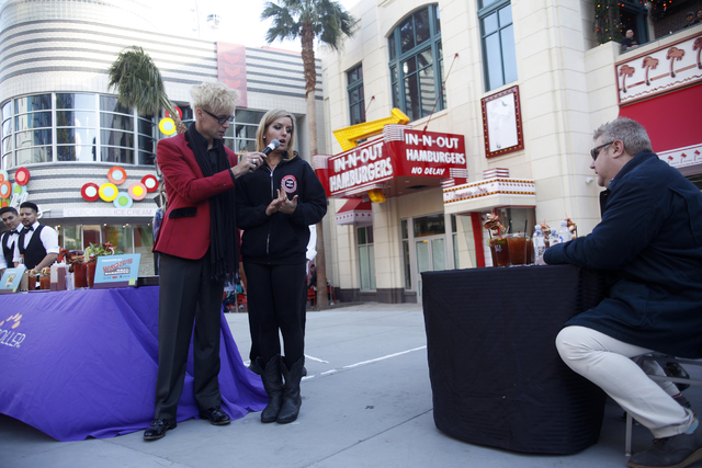 Emcee Murray Sawchuck speaks to contestant Leah Parr at the inaugural National Hangover Day Cocktail Competition at the LINQ Promenade on Sunday, January 1, 2017, in Las Vegas. (Rachel Aston/Las V ...