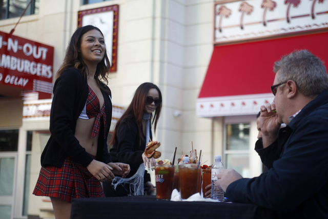 Tara Hough, from the Tilted Pub & Eatery, sets down her bloody mary for the judges at the inaugural National Hangover Day Cocktail Competition at the LINQ Promenade on Sunday, January 1, 2017, ...