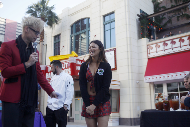 Emcee Murray Sawchuck talks to Tara Hough, from the Tilted Pub & Eatery, before discussing her bloody mary's ingredients at the inaugural National Hangover Day Cocktail Competition at the LINQ ...