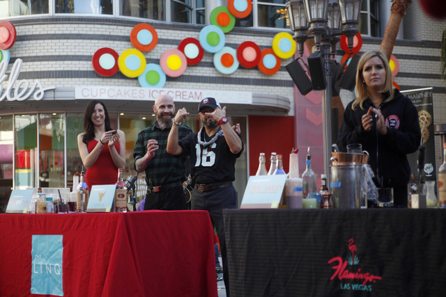 Hared Grajeda puts his hands up after winning second at the inaugural National Hangover Day Cocktail Competition at the LINQ Promenade on Sunday, January 1, 2017, in Las Vegas. (Rachel Aston/Las V ...