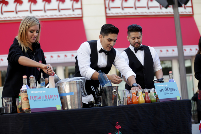 Contestants Leah Barr, Rocco Garcia, and Julian Liwanag make bloody marys at the inaugural National Hangover Day Cocktail Competition at the LINQ Promenade on Sunday, January 1, 2017, in Las Vegas ...