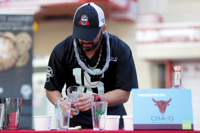 Hared Grajeda makes a bloody mary at the inaugural National Hangover Day Cocktail Competition at the LINQ Promenade on Sunday, January 1, 2017, in Las Vegas. (Rachel Aston/Las Vegas Review-Journal ...