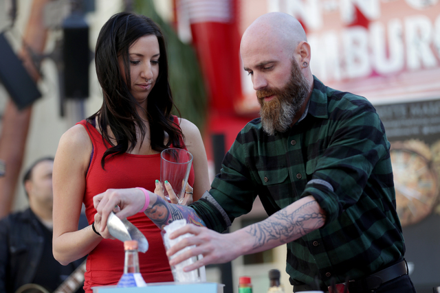"""Anji """"Yoshi"""" Hastings and Jesse Barrett make bloody marys at the inaugural National Hangover Day Cocktail Competition at the LINQ Promenade on Sunday, January 1, 2017, in Las Veg ..."""