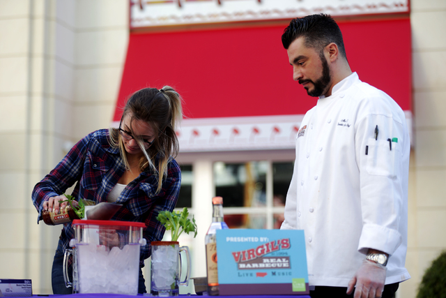 Claudia Durenberger makes a bloody mary as Chef --- watches at the inaugural National Hangover Day Cocktail Competition at the LINQ Promenade on Sunday, January 1, 2017, in Las Vegas. (Rachel Asto ...
