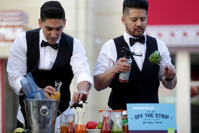 Rocco Garcia and Julian Liwanag make bloody marys at the inaugural National Hangover Day Cocktail Competition at the LINQ Promenade on Sunday, January 1, 2017, in Las Vegas. (Rachel Aston/Las Vega ...
