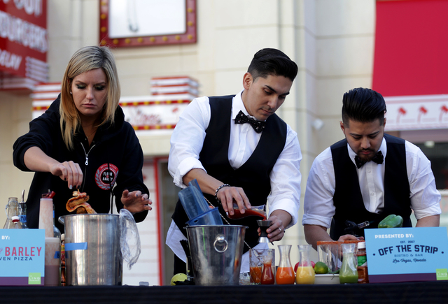 Leah Parr, Rocco Garcia and Julian Liwanag make bloody marys at the inaugural National Hangover Day Cocktail Competition at the LINQ Promenade on Sunday, January 1, 2017, in Las Vegas. (Rachel Ast ...