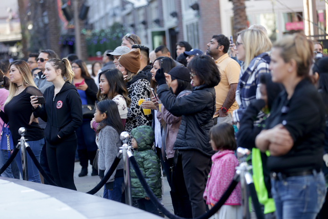 A crowd watches as contestants from local bars participate in the inaugural National Hangover Day Cocktail Competition at the LINQ Promenade on Sunday, January 1, 2017, in Las Vegas. (Rachel Aston ...