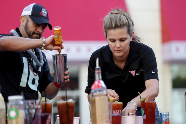 Hared Grajeda and Carrie Carlson make bloody marys at the inaugural National Hangover Day Cocktail Competition at the LINQ Promenade on Sunday, January 1, 2017, in Las Vegas. (Rachel Aston/Las Veg ...