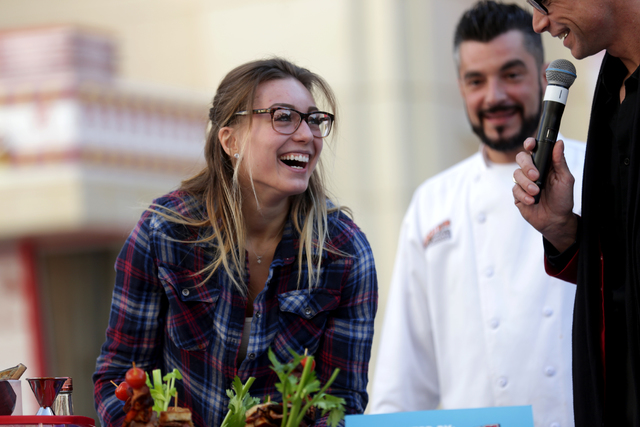 Claudia Durenberger laughs while talking to Emcee Murray Sawchuck at the inaugural National Hangover Day Cocktail Competition at the LINQ Promenade on Sunday, January 1, 2017, in Las Vegas. (Rache ...