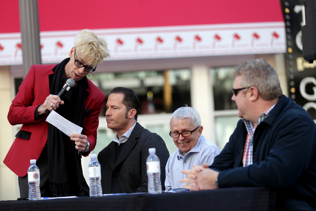 Emcee Murray Sawchuck speaks to Rob Kachelriess, one of the judges, at the inaugural National Hangover Day Cocktail Competition at the LINQ Promenade on Sunday, January 1, 2017, in Las Vegas. (Rac ...