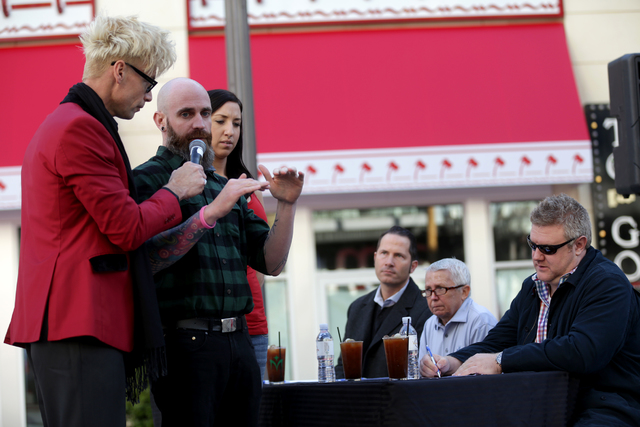 Emcee Murray Sawchuck speaks to contestant Jesse Barrett at the inaugural National Hangover Day Cocktail Competition at the LINQ Promenade on Sunday, January 1, 2017, in Las Vegas. (Rachel Aston/L ...