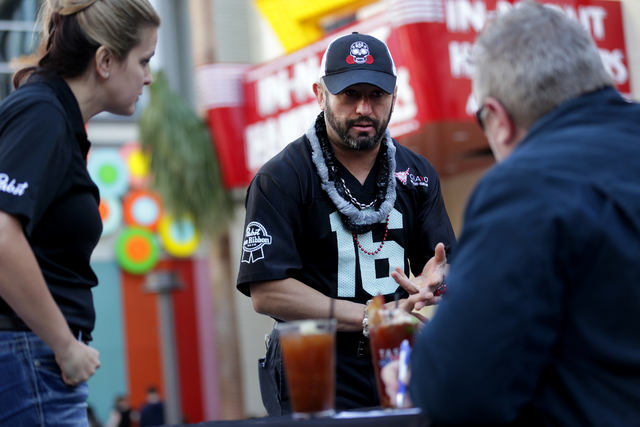 Contestant Hared Grajeda speaks to the judges at the inaugural National Hangover Day Cocktail Competition at the LINQ Promenade on Sunday, January 1, 2017, in Las Vegas. (Rachel Aston/Las Vegas Re ...